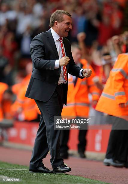 Brendan Rodgers the head coach / manager of Liverpool celebrates as Luis Suarez scores to make it 21