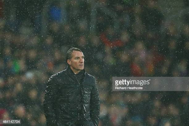 Brendan Rodgers the Liverpool manager looks on in the rain during the Barclays Premier League match between Southampton and Liverpool at St Mary's...