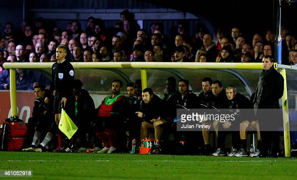 Brendan Rodgers the manager of Liverpool and the Liverpool dugout look on during the FA Cup Third Round match between AFC Wimbledon and Liverpool at...