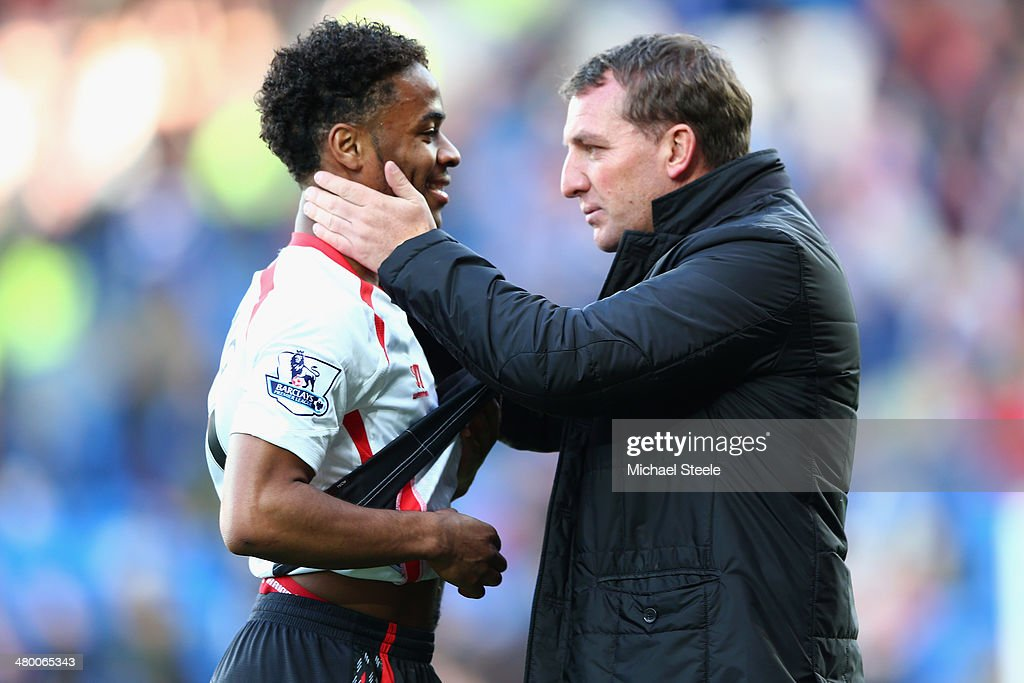 Brendan Rodgers (R) the manager of Liverpool chats with Raheem Sterling after his side's 6-3 victory during the Barclays Premier League match between Cardiff City and Liverpool at the Cardiff City Stadium on March 22, 2014 in Cardiff, Wales.