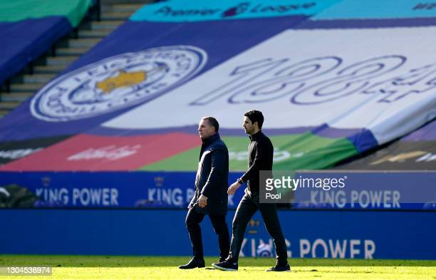 Brendan Rogers, Manager of Leicester City and Mikel Arteta, Manager of Arsenal walks off the pitch after the Premier League match between Leicester...