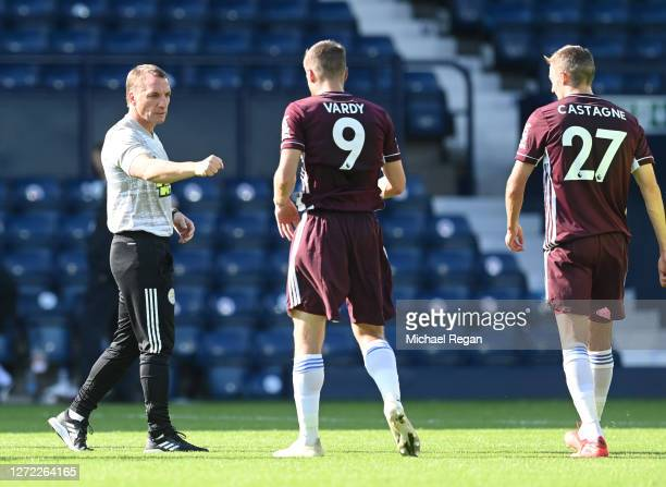 Brendan Rogers Manager of Leicester City celebrates victory with Jamie Vardy of Leicester City after the Premier League match between West Bromwich...