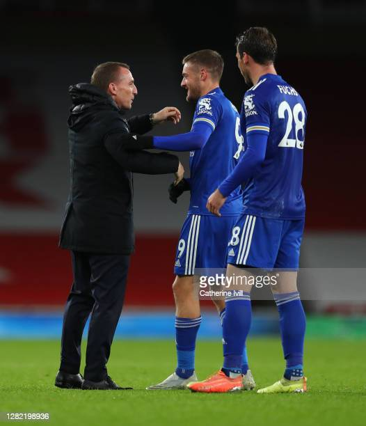 Brendan Rogers Manager of Leicester City embraces Jamie Vardy of Leicester City following their victory in the Premier League match between Arsenal...
