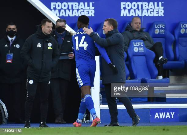 Brendan Rogers, Manager of Leicester City embraces Kelechi Iheanacho as he is substituted off during the Premier League match between Leicester City...