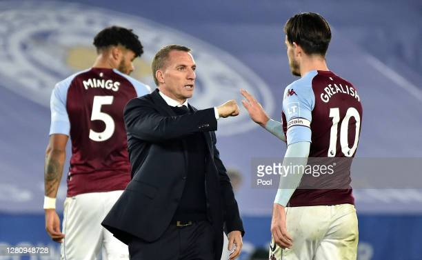Brendan Rogers Manager of Leicester City interacts with Jack Grealish of Aston Villa following the Premier League match between Leicester City and...