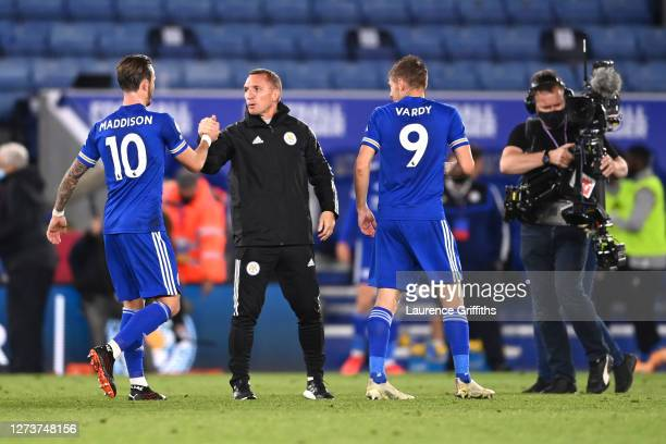 Brendan Rogers Manager of Leicester City interacts with James Maddison of Leicester City following their victory in the Premier League match between...