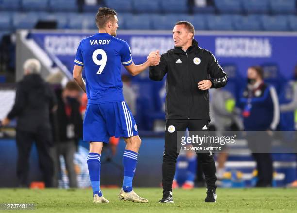 Brendan Rogers Manager of Leicester City interacts with Jamie Vardy of Leicester City following their victory in the Premier League match between...