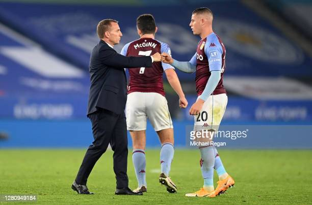 Brendan Rogers Manager of Leicester City interacts with Ross Barkley of Aston Villa following the Premier League match between Leicester City and...