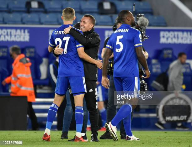 Brendan Rogers Manager of Leicester City interacts with Timothy Castagne of Leicester City following their victory in the Premier League match...