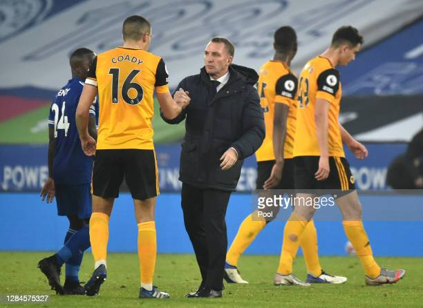 Brendan Rogers Manager of Leicester City shakes hands with Conor Coady of Wolverhampton Wanderers following the Premier League match between...
