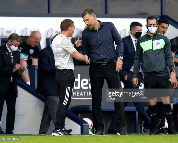Brendan Rogers Manager of Leicester City shakes hands with Slaven Bilic Manager of West Bromwich Albion after the Premier League match between West...