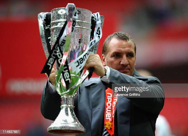 Brendan Rogers of Swansea Citycelebrates with the trophy after victory in the npower Championship Playoff Final between Reading and Swansea City at...