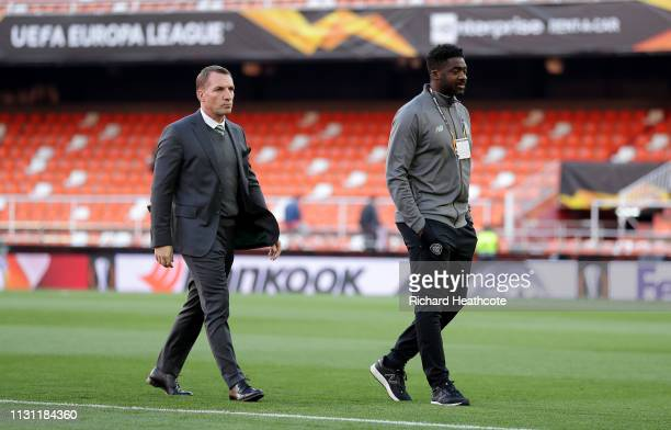 Brendan Rogers the Celtic manger and Kolo Toure of Celtic before the UEFA Europa League Round of 32 Second Leg match between Valencia v Celtic at...