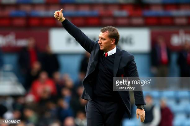 Brendan Rogers the Liverpool manager applauds the travelling fans following their team's 21 victory during the Barclays Premier League match between...