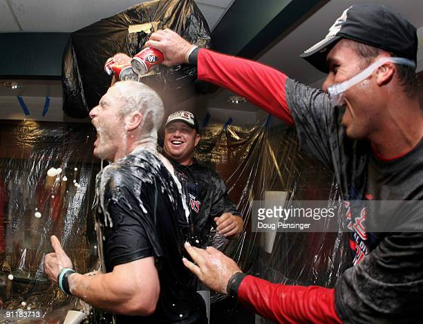 Brendan Ryan is doused by teammates as the St Louis Cardinals celebrate clinching the National League Central Division after defeating the Colorado...