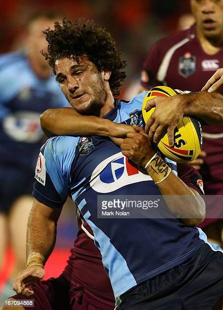 Brendan Santi of NSW is tackled during the U20s State of Origin match between New South Wales and Queensland at Centrebet Stadium on April 20, 2013...