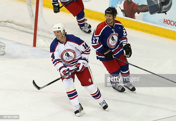Brendan Shanahan and Scott Niedermayer skate in the 2013 Hockey Hall of Fame Legends Classic game at the Mattamy Athletic Center on November 10 2013...