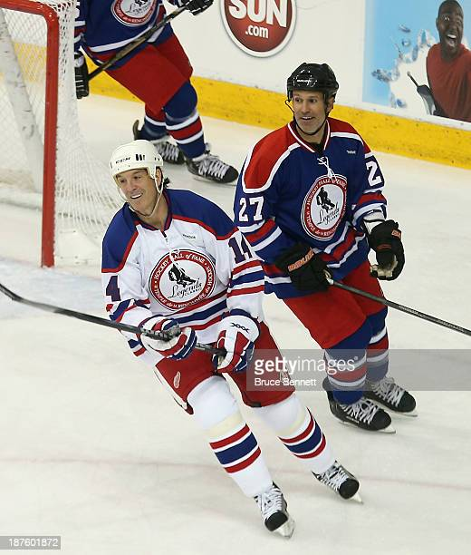 Brendan Shanahan and Scott Niedermayer take part in the 2013 Hockey Hall of Fame Legends Classic game at the Mattamy Athletic Center on November 10...