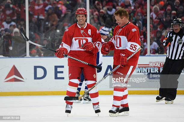 Brendan Shanahan of the Detroit Red Wings celebrates his firstperiod goal against the Toronto Maple Leafs with Larry Murphy during the 2013...