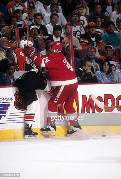 Brendan Shanahan of the Detroit Red Wings checks Janne Niinimaa of the Philadelphia Flyers into the boards during the 1997 Stanley Cup Finals in June...