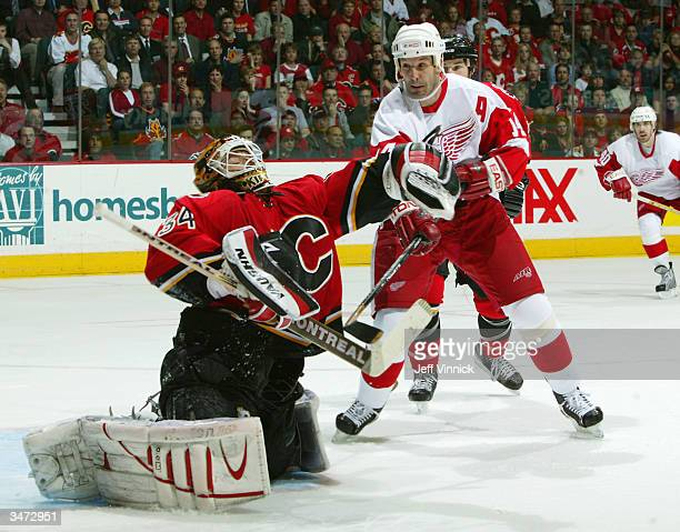 Brendan Shanahan of the Detroit Red Wings looks for the rebound as Miikka Kiprusoff of the Calgary Flames makes a glove save during the third period...