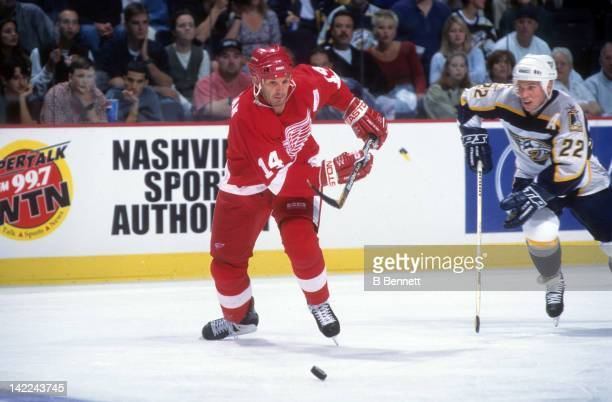 Brendan Shanahan of the Detroit Red Wings skates with the puck during an NHL game against the Nashville Predators circa 2000 at the Gaylord...