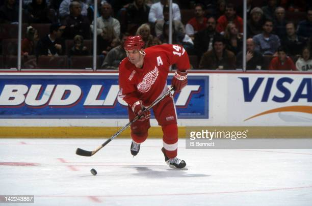 Brendan Shanahan of the Detroit Red Wings skates with the puck during an NHL game circa 2000