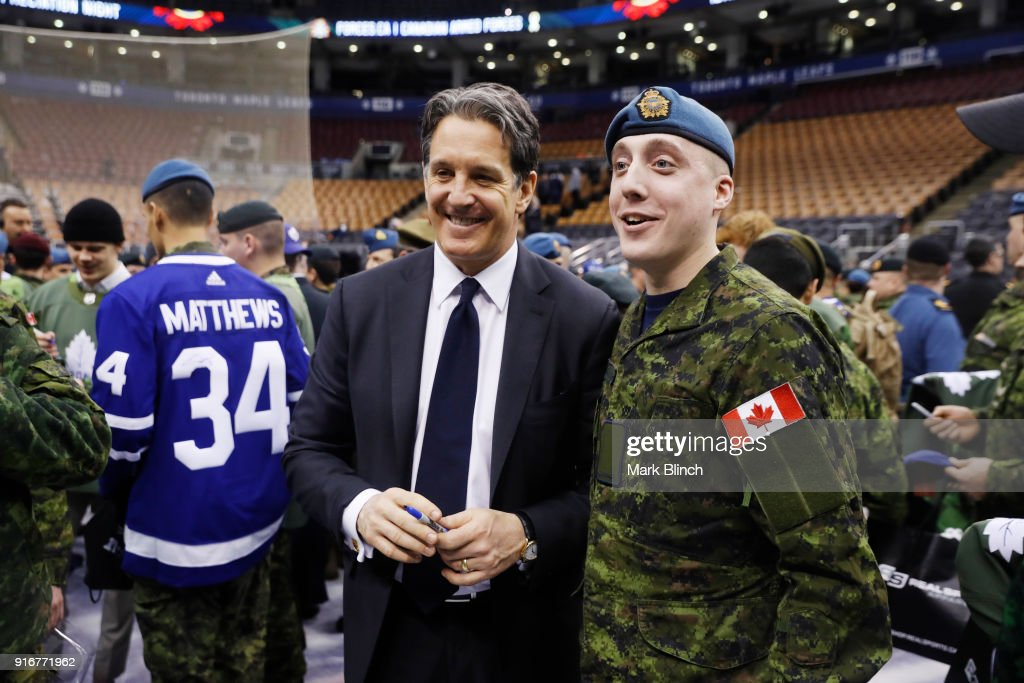 Brendan Shanahan, President of the Toronto Maple Leafs stands with members of the Canadian Armed Forces during Military Night at the Air Canada Centre on February 10, 2018 in Toronto, Ontario, Canada.