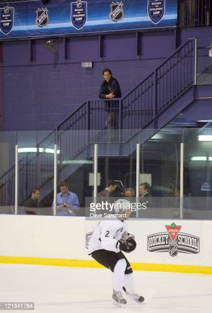 Brendan Shanahan Sr vice president of NHL Player Safety and Hockey Operations watches an on ice session as Cody Ceci of Team White skates by during...