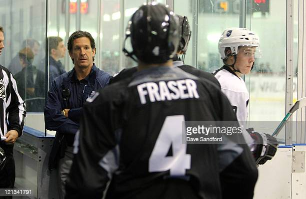 Brendan Shanahan Sr vice president of NHL Player Safety and Hockey Operations looks on as players hit the ice during the NHL Research Development and...
