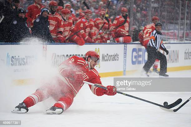 Brendan Smith of the Detroit Red Wings loses an edge and falls to the ice in the first period against the Toronto Maple Leafs during the 2014...