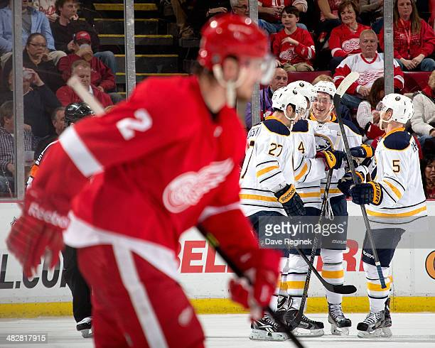 Brendan Smith of the Detroit Red Wings skates out of the penalty box as Matt D'Agostini Luke Adam and Chad Ruhwedel of the Buffalo Sabres...