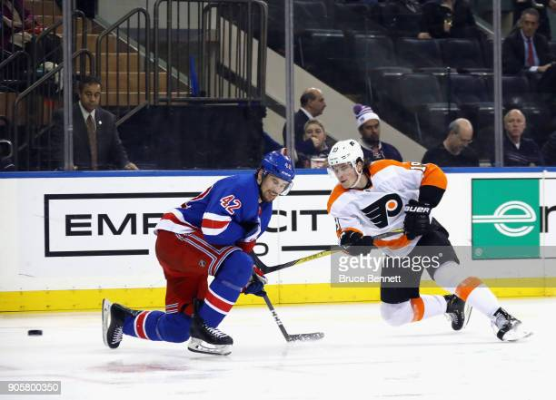 Brendan Smith of the New York Rangers blocks a shot by Nolan Patrick of the Philadelphia Flyers during the third period at Madison Square Garden on...