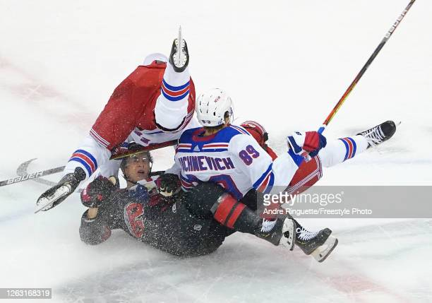 Brendan Smith of the New York Rangers hits Martin Necas of the Carolina Hurricanes during the first period in Game One of the Eastern Conference...