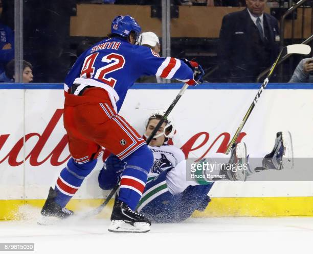 Brendan Smith of the New York Rangers steps into Jake Virtanen of the Vancouver Canucks during the third period at Madison Square Garden on November...