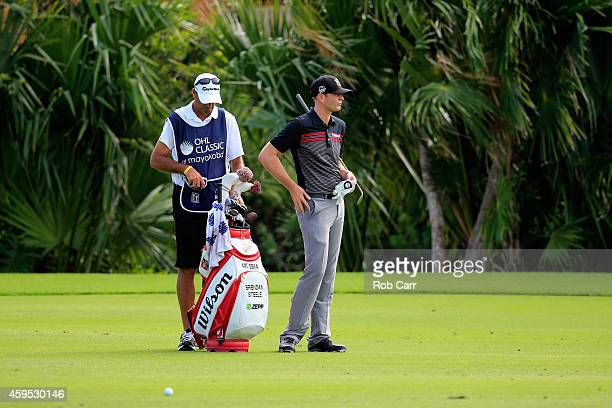 Brendan Steele of the United States and his caddie line up a shot on the 17th hole during the final round of the OHL Classic at the Mayakoba El...