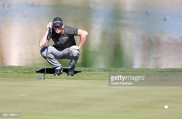Brendan Steele of the United States lines up his putt on the ninth hole during the final round of the Humana Challenge in partnership with The...