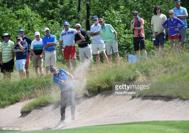 Brendan Steele of the United States plays his shot from a bunker on the fourth hole during the final round of the 2017 US Open at Erin Hills on June...