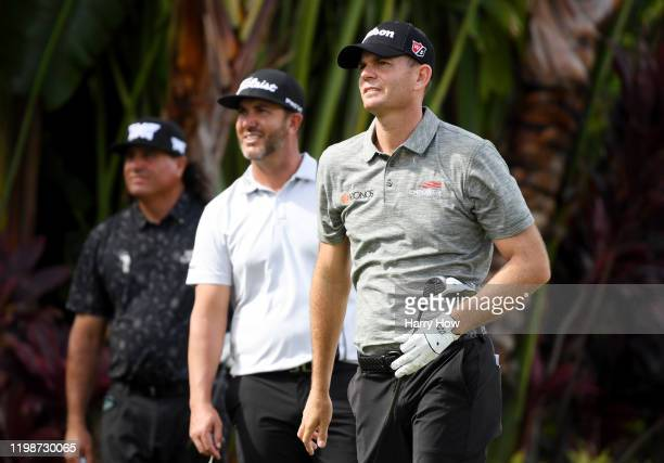 Brendan Steele of the United States plays his shot from the ninth tee as Scott Piercy of the United States and Pat Perez of the United States look on...
