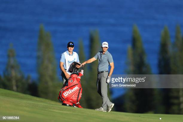 Brendan Steele of the United States pulls a club from his bag as he prepares to play a shot on the fourth hole during the third round of the Sentry...
