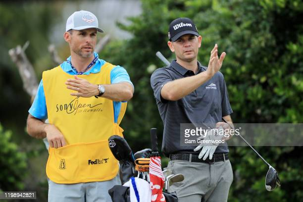 Brendan Steele of the United States talks with his caddie during the third round of the Sony Open in Hawaii at the Waialae Country Club on January 11...