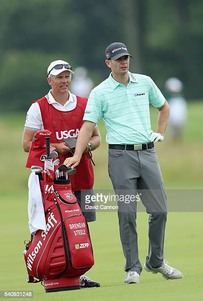 Brendan Steele of the United States waits to take his shot on the ninth hole during the continuation of the weather delayed first round of the US...