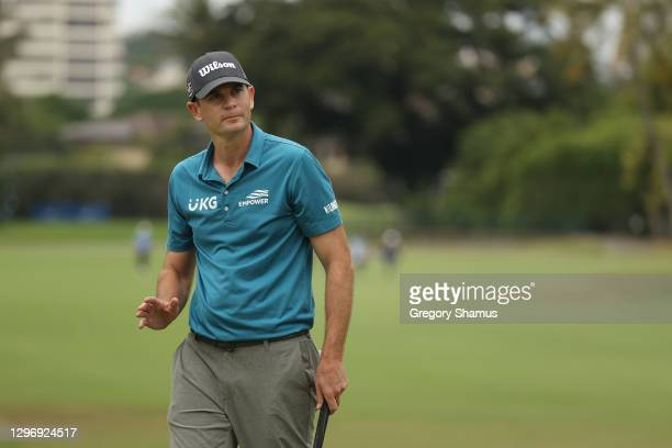 Brendan Steele of the United States waves after making an eagle on the ninth green during the final round of the Sony Open in Hawaii at the Waialae...