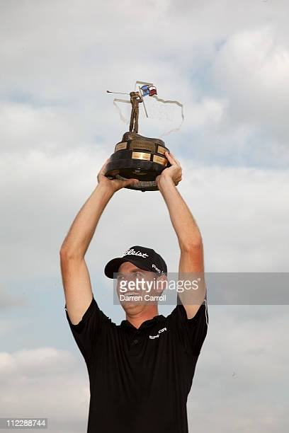 Brendan Steele poses with the champion's trophy after winning the Valero Texas Open at the ATT Oaks Course at TPC San Antonio on April 17 2011 in San...