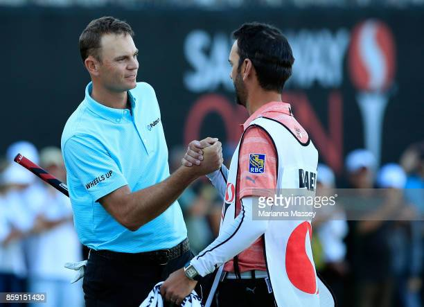 Brendan Steele shakes hands with Graham DeLaet's caddie Julien Trudeau after finishing his round on the 18th hole during the final round of the...