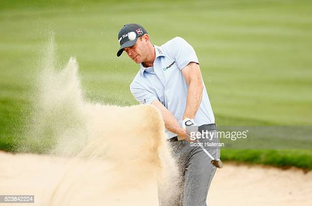 Brendan Steele takes his shot out of the bunker on the fifth hole during the final round of the Valero Texas Open at TPC San Antonio ATT Oaks Course...