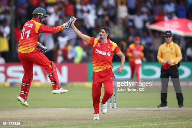 Brendan Taylor and Graeme Cremer of Zimbabwe celebrate the wicket of Shimron Hetmyer of The West Indies during The Cricket World Cup Qualifier...