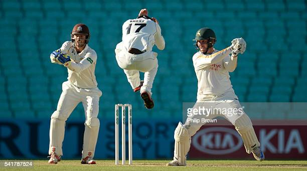 Brendan Taylor of Nottinghamshire has Rory Burns of Surrey jumping during day two of the Specsavers County Championship Division One match between...