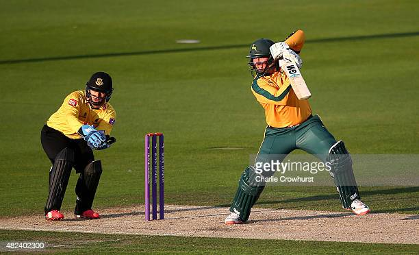 Brendan Taylor of Nottinghamshire hits out while Craig Cachopa of Sussex looks on during the Royal London OneDay Cup match between Sussex and...