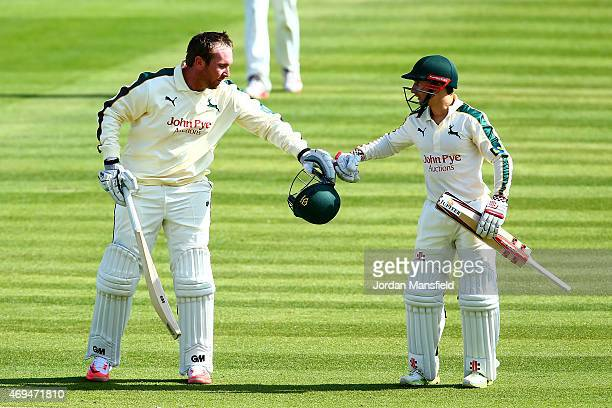 Brendan Taylor of Nottinghamshire is congratulated by James Taylor of Nottinghamshire after making his century during day one of the LV County...